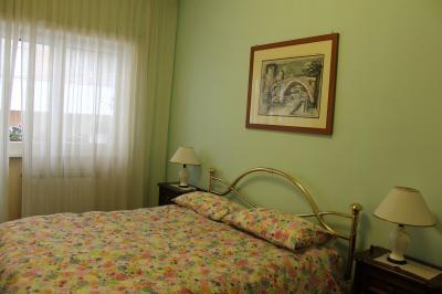 Schlafzimmer 1 Mietobjekt Appartement 66395 Rom